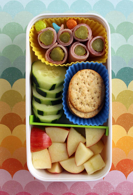 Wrap ham slices around pickles, cut into chunks and secure with a cute pick.