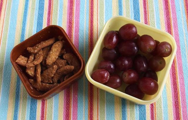 Garlic sesame sticks and grapes