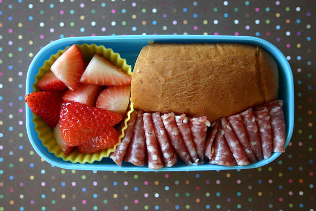 Wyatts favorite bento: salami, strawberries and a bun.